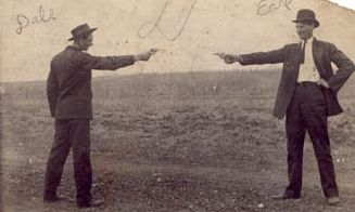 Gunfighters doing what gunfighters do.